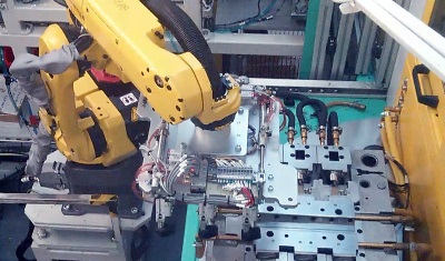Leak Test Cell with Robotic Handling